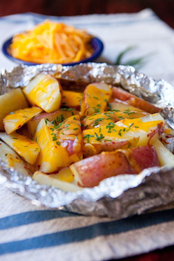 I went through a phase in my grilling education where I was convinced that you could cook almost anything in a foil packet. I've since moved on to other grilling obsessions, but potatoes have stayed firmly in their foil packets. Potatoes are quite possibly the perfect foil packet food, turning slightly crispy on the edges and tender on the inside. Adding a layer of melted cheese to these grilled potatoes near the end makes them irresistible!