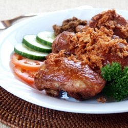 Indonesian Style twice cooked chicken first boiled in water with aromatic spices then deep fried