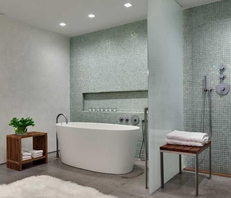 A Recessed Tile Shelf And Wall Mounted Shower Accompany The Soaking Tub In  This Bath
