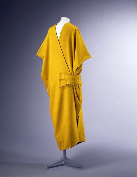Paul Poiret mantle, 1913. 'Based on a deconstructed kimono, it is composed of two rectangles folded on the shoulders and joined on one side with a stylised bow. It illustrates how Poiret was able to combine with rare harmony the bold colours of Fauvism, the vision of Cubism and the exoticism of Eastern garments.' PAUL POIRET