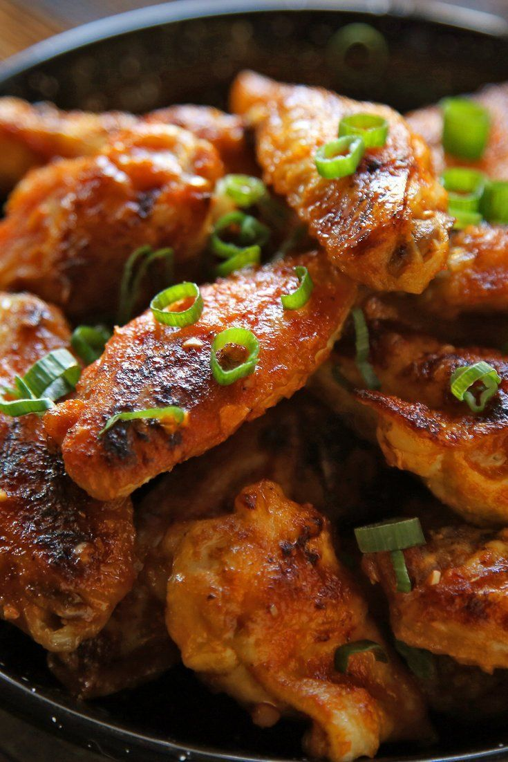 "NYT Cooking: Americans are a wing-loving people. The Buffalo variety, by most accounts ""invented"" at the Anchor Bar in, yes, Buffalo, is the official food of our most sacred event of the year: the Super Bowl. These can be made on the grill or in the oven."