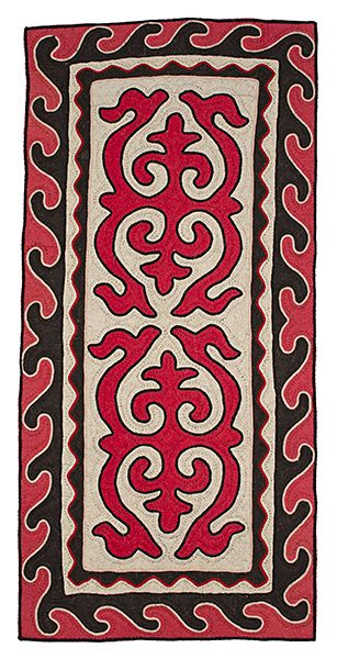 Small shyrdak runner rug from Felt combining all-natural, un-dyed, white and dark brown wool felt with red and pink coloured wool felt and braid in white, black and red coloured wool 0.65m x 1.3m feltrugs.co.uk