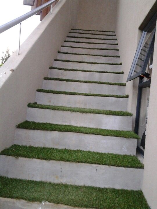 Artificial grass carpet on the outside stairs