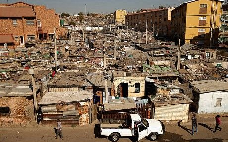 Shacks stretch on to the horizon in Alexandra Township in Johannesburg (GETTY), Telegraph