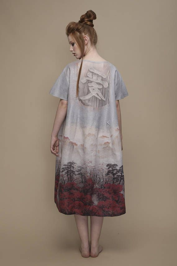 A very light summer dress, Oversize, with a short sleeve, ends after the knee line. The dress has elements of Chinese style. The dress made from natural materials- natural silk, wool 18 microns and viscose fibers. All materials are delicate, pleasant to the body and are characterized