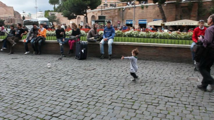 ciao uccellino! hello little bird!. eleanor (at 21 months) tries to befriend a pigeon in rome.
