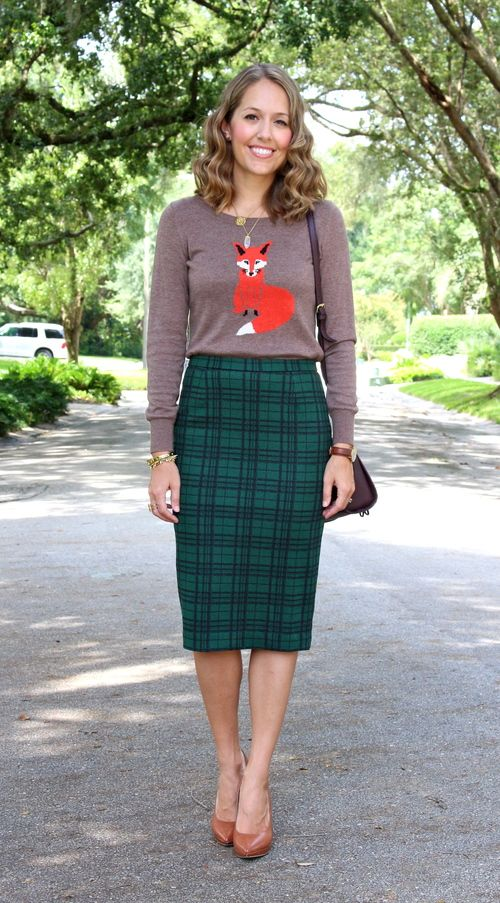 Fox sweater with green plaid skirt