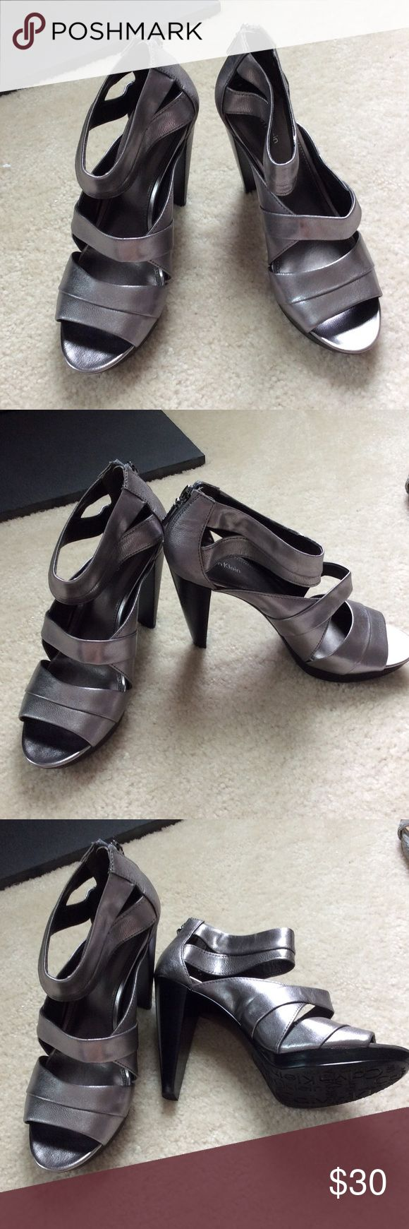 Calvin Klein Deliah 9 silver sandals zip up CK ladies 9 silver zip up sandal new without tags. No sign of wear.  Heal is 3.5 inches. Calvin Klein Shoes Sandals