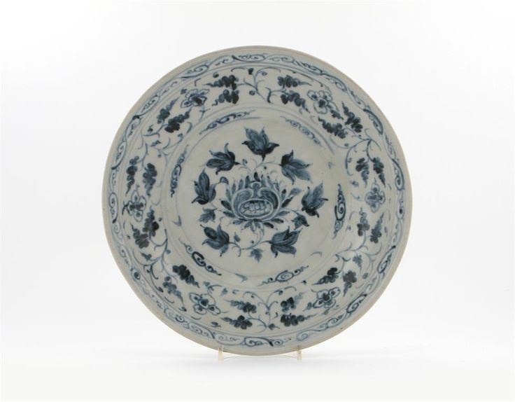 An Annamese blue and white dish, decorated with a central stylized flower head, bordered by flower and leaf scroll, the reverse with lappets and a brown wash inside the foot, 14th century, the rim ground, 37.3cm. Provenance: Purchased in Singapore, 20th January 1958. Exhibited: Hetjens Museum, Düsseldorf, Chinesische Keramik, 21st March - 2nd May 1965, no.97. Cf. J. A. Pope, Chinese Porcelains from the Ardebil Shrine, pl.57; A Joseph, Chinese and Annamese Ceramics, nos.97-102, from the Ian…