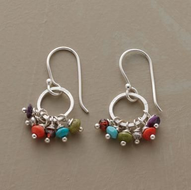 """Colorful stones from around the world convene in a playful cluster: gaspeite, sugilite, coral, garnet and turquoise. Handmade in USA with Thai silver hoops and French wires. 1-1/8""""L."""