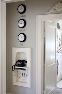 Nice idea - opening up the wall and creating a docking station for cell phones, cameras, etc.