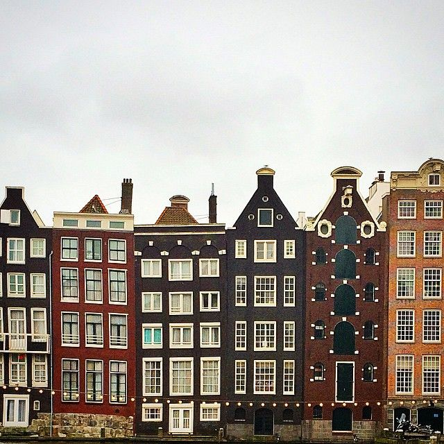 Charmingly crooked canal houses in Amsterdam. Photo courtesy of theonewithwanderlust on Instagram.