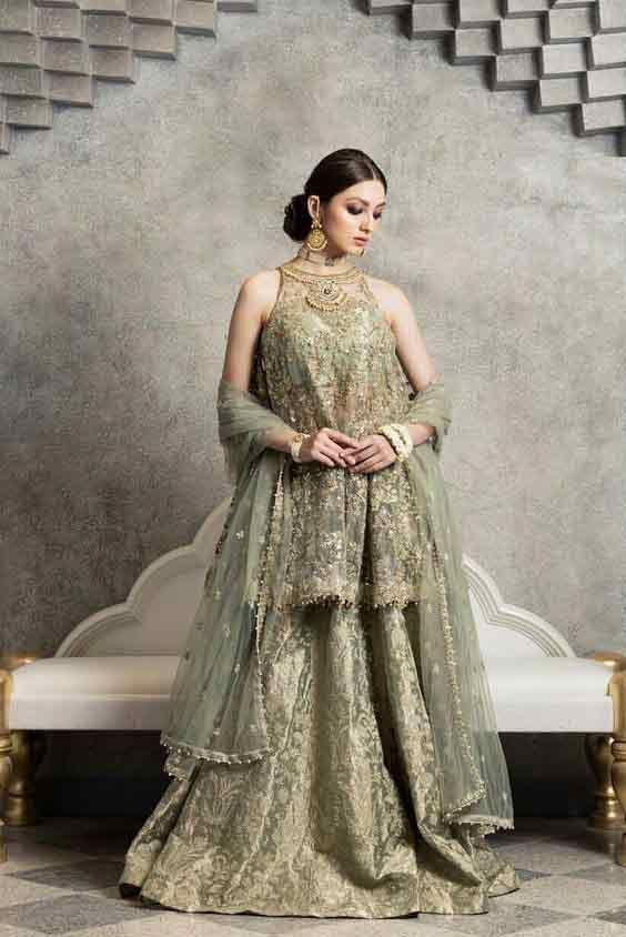 95523378f22bd3 Pakistani green peplum dress with lehenga for wedding brides ...