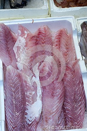 Fish Fillets In Market - Close up of pink raw fresh fish fillets. Photo taken on: October 29th, 2016