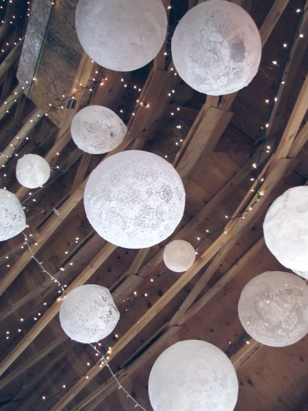 barn wedding lights lace balls wood rustic party event lace white 1940s colorado