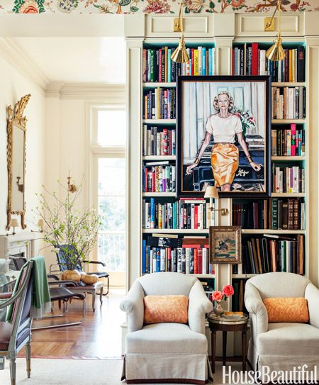 """Display Artwork A Peter Rogers portrait of Alex Hitz's close friend, the late Nan Kempner, hangs in the library of his Los Angeles house. """"The room doesn't get a lot of light, so I decided to make it cozy and turned it into an English-style portrait room, which is ridiculous, but fun,"""" he says."""