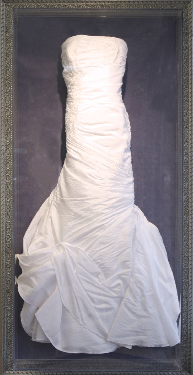 Preserve your wedding dress in a custom framed shadowbox.  Perfect way to showcase a gorgeous gown!  Design by Art and Frame Express in Edison NJ