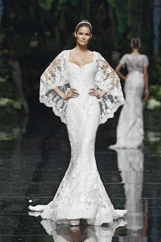 so pretty spanish wedding style looking shoulder covering wedding dress fish tail .