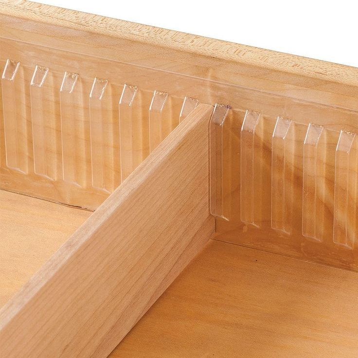 Drawer Divider Holder - Clear plastic, adhesive-backed, cut to length. See http://www.iheartorganizing.com/2016/05/uheart-organizing-easy-does-it-diy.html for applications.