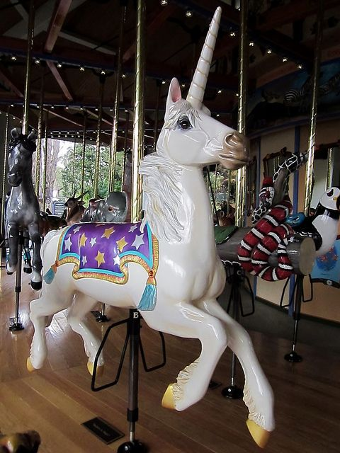 A unicorn at the Los Angeles Zoo.  I'm thinking the thing next to it is a snake?  On a carousel?