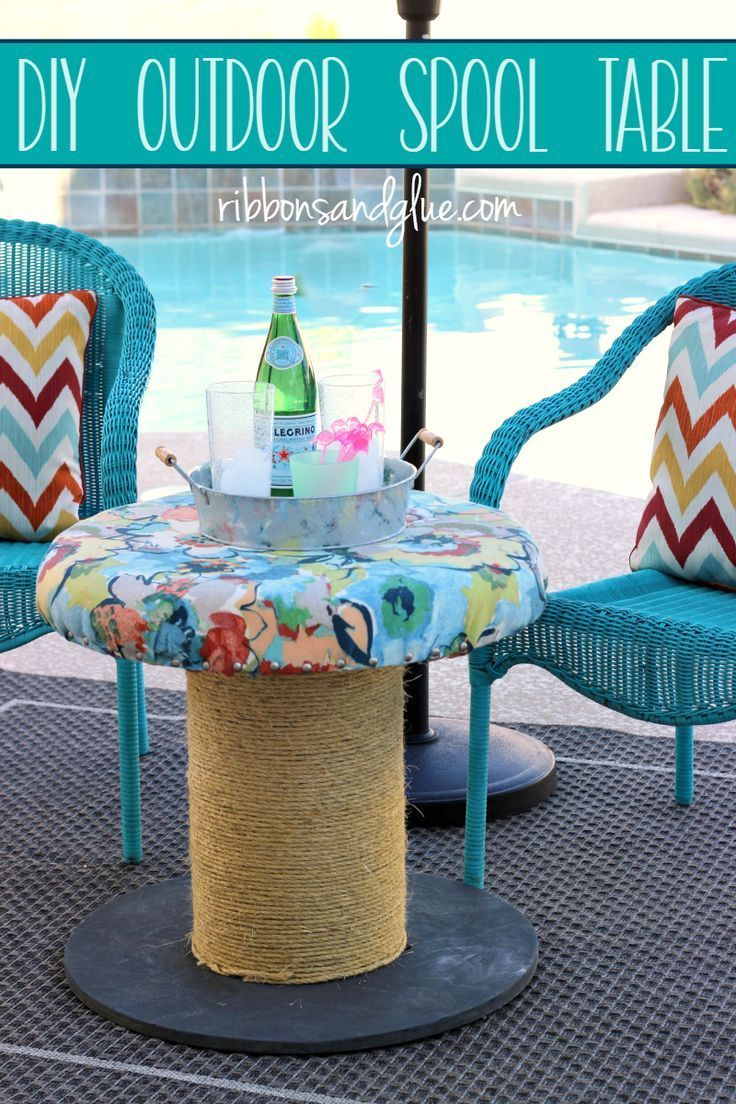 DIY Outdoor Spool Table made from a wooden spool. Simple outdoor seating or side table made over with outdoor fabric and rope.  #ForWhatMattersMost  #ad @target