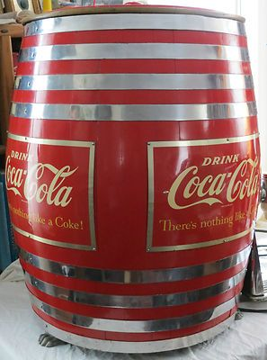 "This is a Vintage / Antique "" Coca-Cola "" Wooden Barrel form Soda Fountain Dispenser . It's features include Three ( 3 ) spigot "" Multiplex "" Dispenser Heads ( one assigned "" Coca-Cola & one assigned "" Root Beer "" . the third is not assigned ), Oak Stave Keg Barrel in Coca Cola Red finish & trimmed in Chrome Plated Bands , Two metal "" Coca-Cola "" signs attached to the Barrel , Three cast metal "" Paw "" feet and a separate cooling unit with thermostat . This is an ICONIC piece of Americana !"