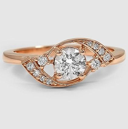 Swirls of pavé set diamonds appear to float around the center diamond in this uniquely beautiful, Retro-inspired ring.