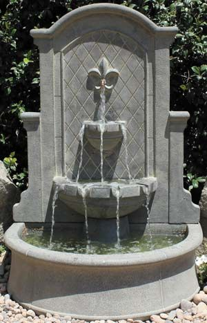 "2160-FW Fleur-De-Lis Wall Fountain       2160-FW Fleur-De-Lis Wall Fountain Shown in Tache Blanche Pump 500 GPH Height 49""  Width 34""  Depth 25""   2060-T Top Component 2060-PH Pump House 2060-B Basin"