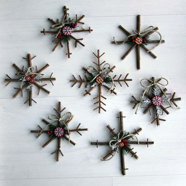 Rustic Snowflakes -  (No tutorial) -  Use twigs to make the snowflakes. Decorate with pine needles, buttons, twine and ribbons.