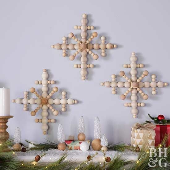 Follow our tutorial to learn how to make these DIY snowflakes, then hang a trio of them above your mantel for a winter wonderland scene.