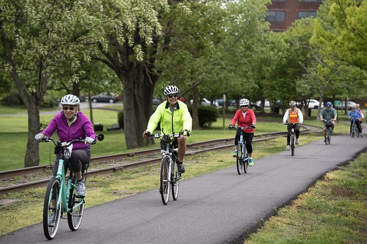 Baby boomers join 'aging-at-home villages' for yoga, happy hour, cooking classes and biking. Neighborhood groups, set up to assist seniors with errands and doctors, are turning social.