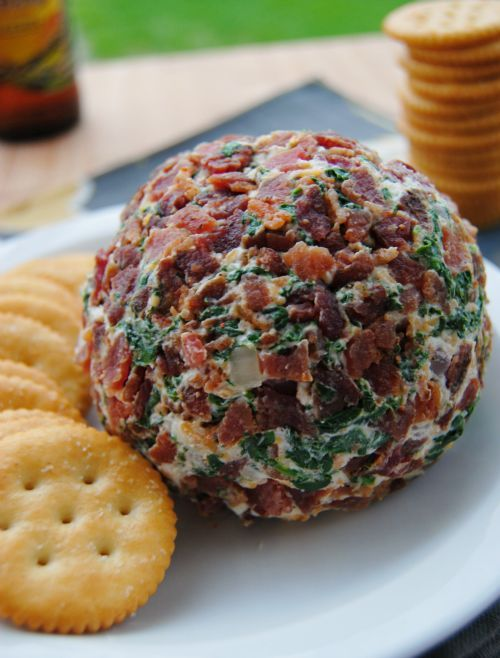 Bacon Spinach Cheese Ball:     6 slices bacon,     6 ounces fresh spinach,     1/2 teaspoon kosher salt,     1/2 cup onion, finely minced,     2 cloves garlic, finely minced,     1 (8 ounce) block of cream cheese, softened,     1/2 cup shredded cheddar jack cheese,     1/4 teaspoon cayenne pepper