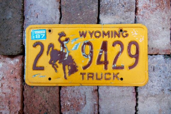 Old wyoming truck license plate 29429 in yellow and brown for Garage ad buc