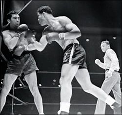 June 22 1938 - American boxer Joe Lewis defeated German Max Schmeling by one knockout in the first round. His victory made Lewis the US's first African American sports hero. Rather than being enemies, Lewis and Schmeling became close friends. The two men visited each other often and Schmeling was a pallbearer at Lewis's funeral.