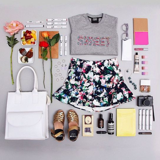 how to style instagram photos like a blogger: organization - floral shorts paired with a graphic t-shirt, gold + black sandals, a white leather tote and handful of stylish accessories