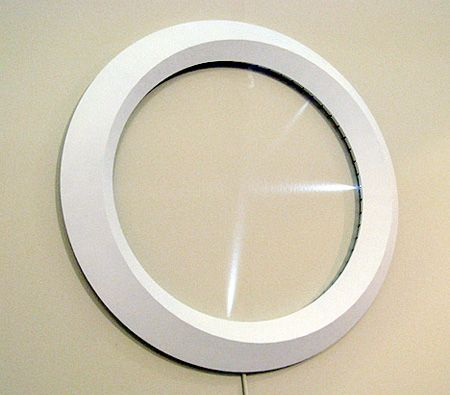 Faceless Clock -  Good Afternoon wall clock by Mile Project shows time using light. [link]