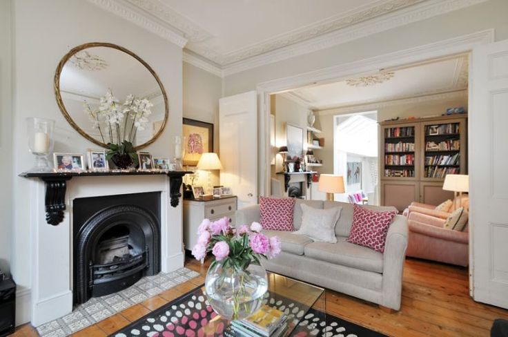 The living room makes the most of all the property's beautiful period features