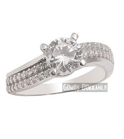 Gümüş Tek Taş Yüzük Modelleri - Beyaz zirkon taşları ile süslenmiş her bayanın hayali olan gümüş tektaş yüzüğün ağırlığı 3 gr taş genişliği 0,6 mm. Gümüş tektaş modeli zarif , şık görüntüsünden ödün vermezken fiyatıyla da şaşırtmakta! Gümüş ile ilgili aradığınız herşeyi uygun fiyatlara bulmak Gümüş Dükkanı`nda çok kolay! / http://www.gumusdukkani.com/gumus_tektas_yuzuk/gumus-tek-tas-yuzuk-modelleri