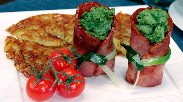This one's for the kids and the young at heart! For a decorative presentation of Chef Michael P. Clive's green eggs and ham, wrap the ham around a metal pastry cutter or metal measuring cup. Tie the ham in place...