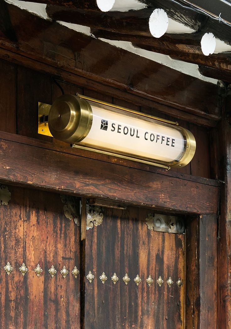 Traditional Korean Home Reclaimed To Form Light Filled Seoul Coffee Shop Restaurant Signage Signage Design Architectural Signage