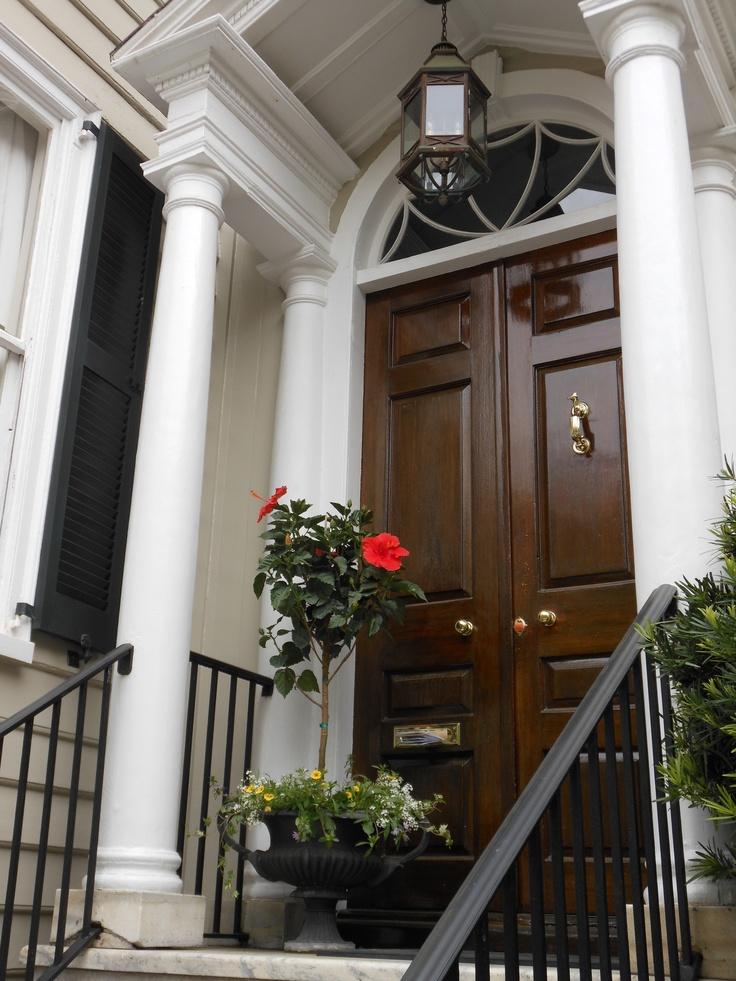 Mahogany door, columns, Palladian light= perfection!