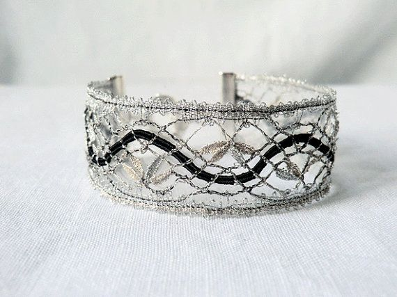 bracelet, handmade bobbin lace out of yarn, black and silver, silver coated fastener, klöppeln, dentelle, kant, lace, handmade, inana no1043