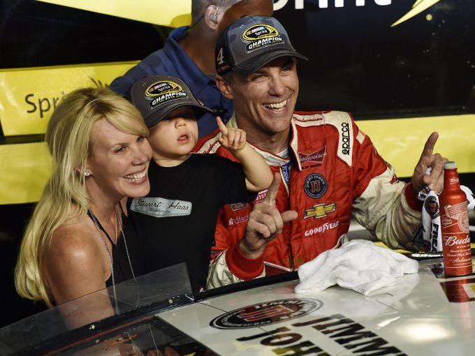 Champion 2014 Kevin Harvick,& family right, celebrates his 2014 NASCAR Sprint