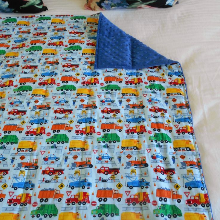 Kids size weighted blanket, 150 x 100 cm, 4 kg. Trucks cotton fabric & minky dot fabric. $143 + delivery. Many other sizes, weights and fabrics available.