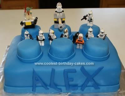 Homemade Star Wars Lego Cake: I wanted to make a Lego cake for our son's 10th Birthday. We experimented with a single sheet cake with cupcakes on top and then just plain old icing.