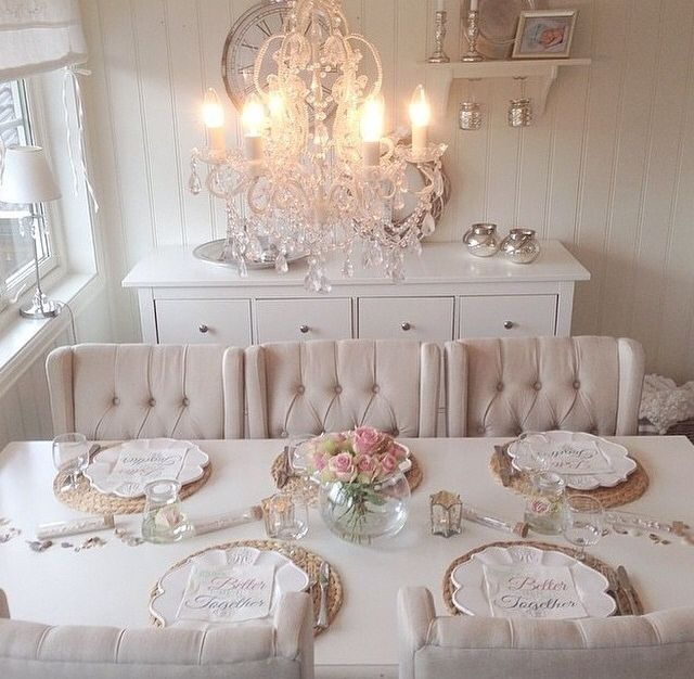 "This very pretty chandelier adds a ""bit-'o-bling"" to a sweet, Shabby Chic dining space."