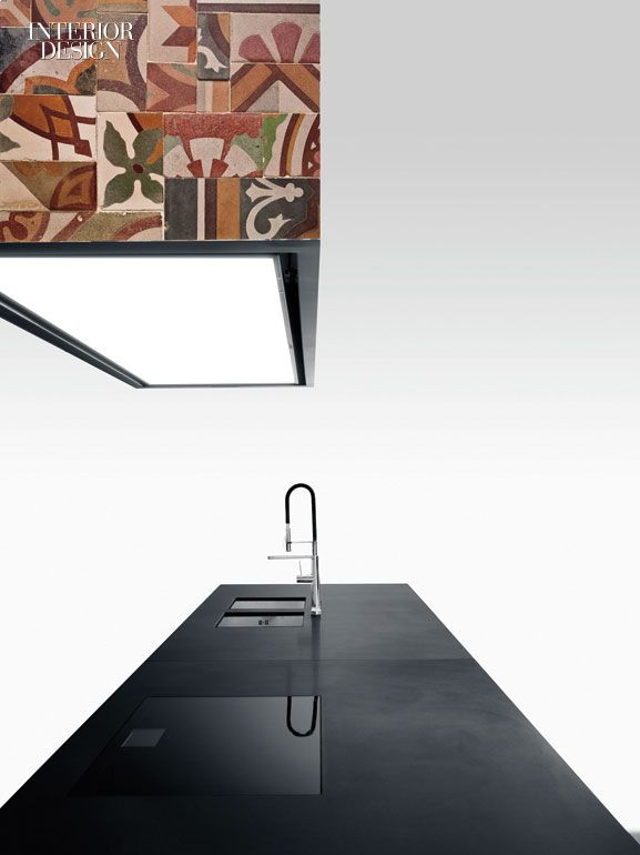 Piero Lissoni's Tile Hood vapor extractor clad in Domenico Mori's antique Pastine tile by Boffi.