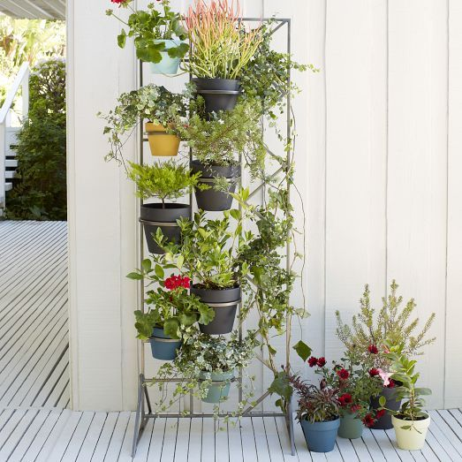 A green accent wall. Our Deco Screen Wall Planter features brackets that accommodate up to seven standard planter pots. Made of galvanized iron, it's perfect for creating a vertical garden on your terrace or a living, breathing room divider in your family room. Coordinates with Chalkboard Planters (sold separately).