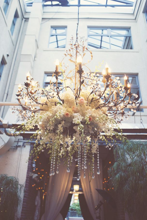 beautiful chandelier decorated with florals and crystals | vancouver nerdy wedding teal (86)