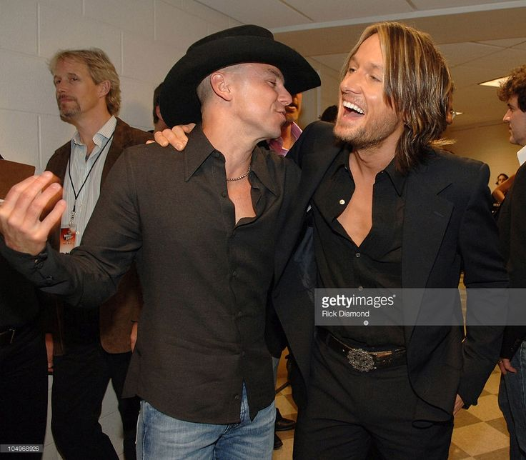 Kenny Chesney and Keith Urban during 2006 CMT Music Awards - Backstage and Audience at Curb Event Center at Belmont University in Nashville, Tennessee, United States.